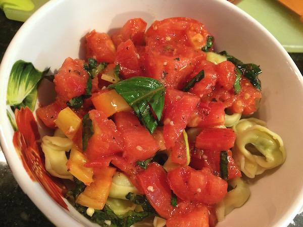 Fresh tomato sauce, tortellini, & grilled chicken