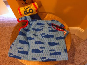 Sewing a toddler bib or smock is a quick diy project that helps keep mealtime a little neater. Toddler smock can be used for meals or art time.