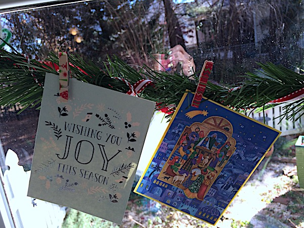 Christmas cards – display with garland, clothespins