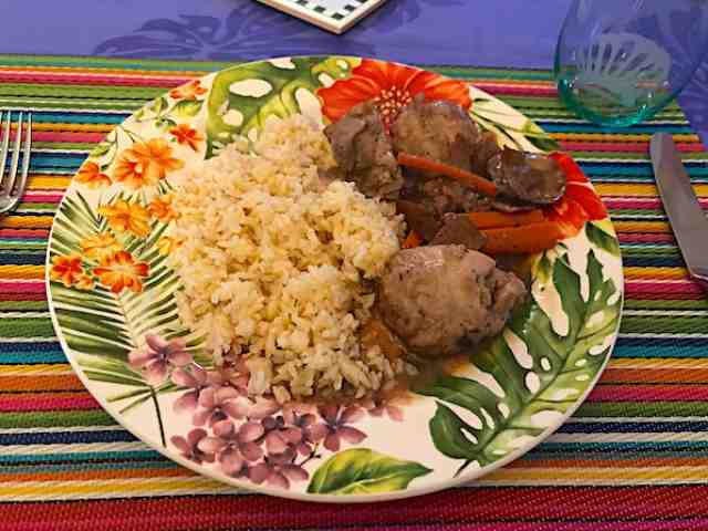 Coq au vin is a French chicken stew with chicken, wine, mushrooms, and carrots. Serve over rice or mashed potatoes.